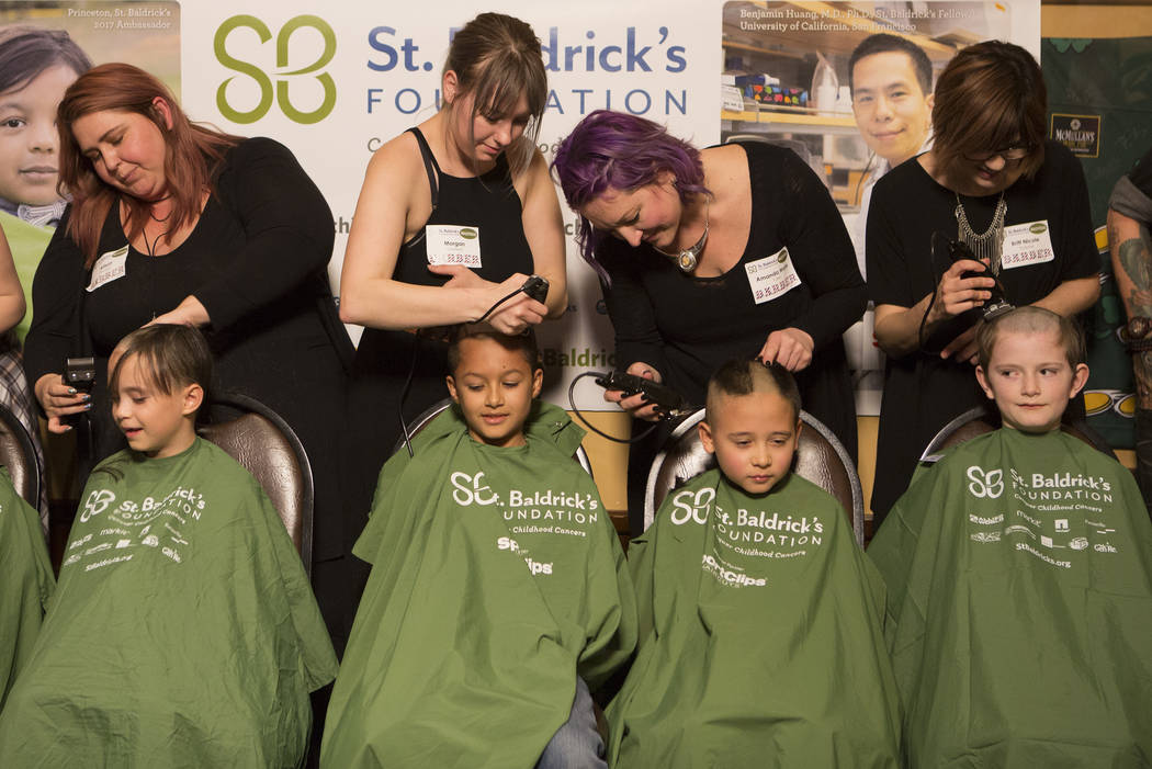"Kids get their head shaved in part of ""Shave for the Cure"" a St. Baldrick's event held at McMullan's Irish Pub on Saturday, March 4, 2017, in Las Vegas.(Bridget Bennett/Las Vegas Review- ..."