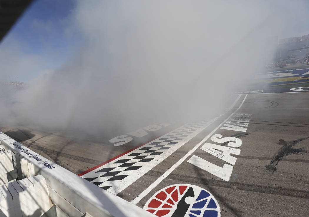 Martin Truex Jr. (78) celebrates with a burnout after winning during the Monster Energy NASCAR Cup Series Kobalt 400 auto race at Las Vegas Motor Speedway in Las Vegas on Sunday, March 12, 2017. ( ...