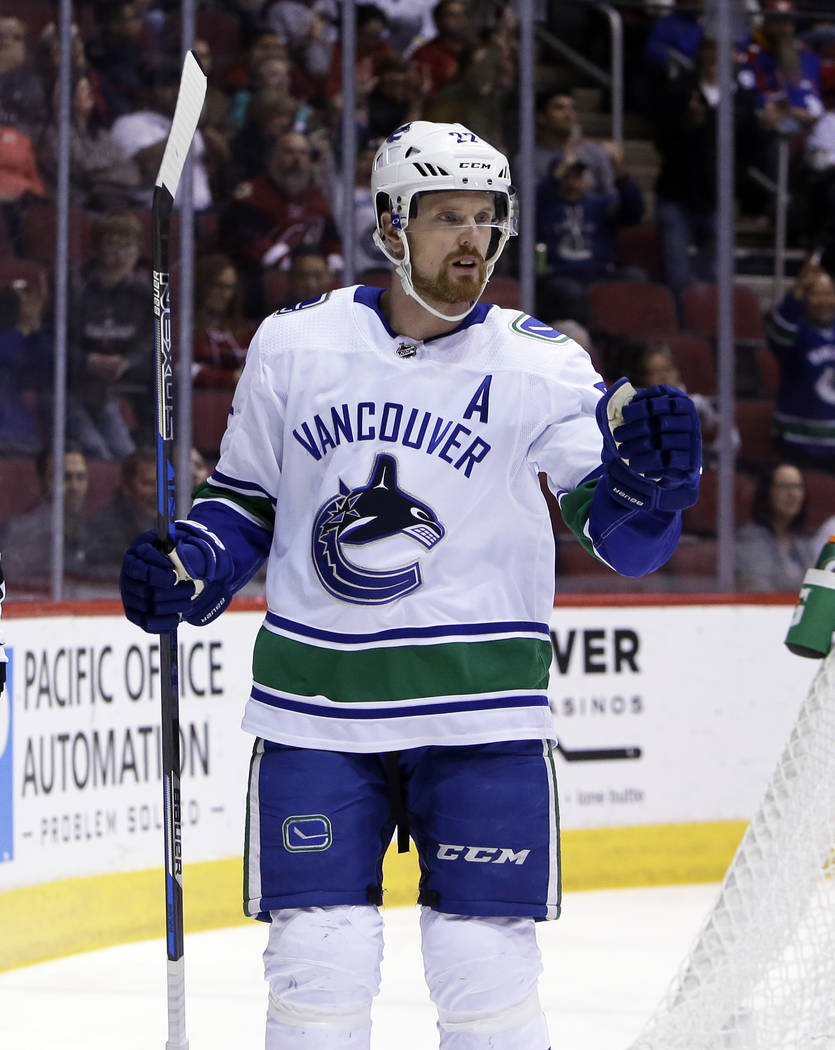 Vancouver Canucks left wing Daniel Sedin reacts after scoring a goal in the first period during an NHL hockey game against the Arizona Coyotes, Sunday, Feb. 25, 2018, in Glendale, Ariz. (AP Photo/ ...
