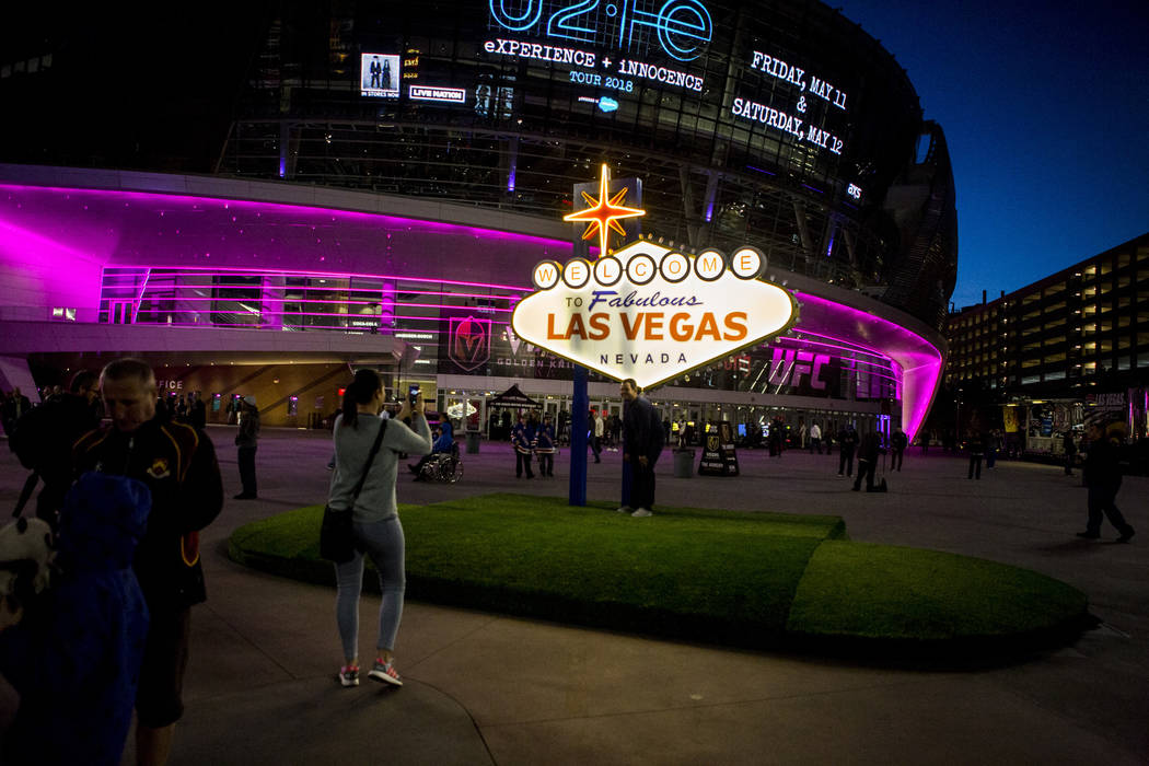 Pep rally attendees take photos with a scale model of the Las Vegas sign on Toshiba Plaza outside of T-Mobile Arena on Wednesday, Feb. 28, 2018.  Patrick Connolly Las Vegas Review-Journal @PConnPie