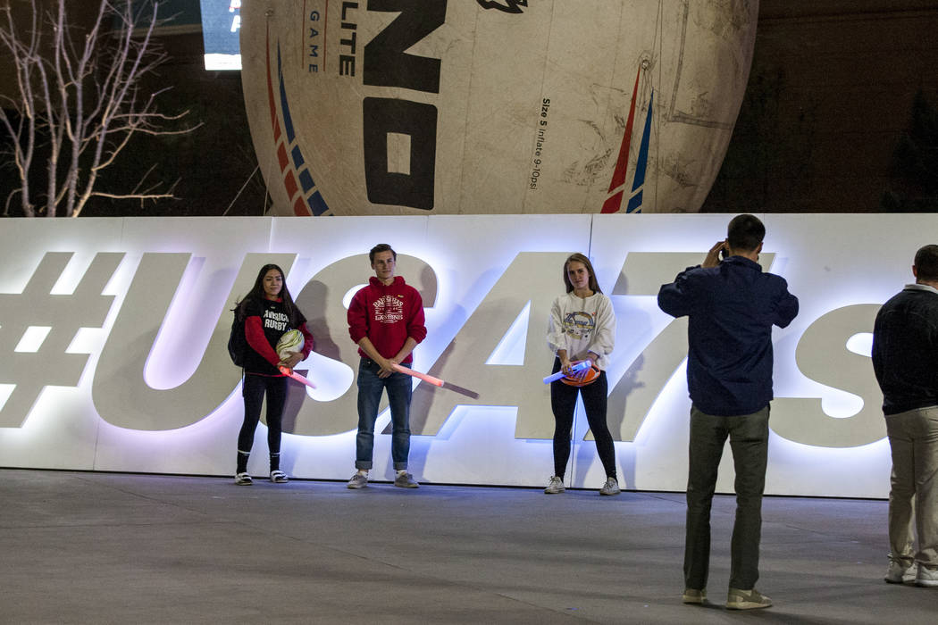 Pep rally attendees have their photo taken in front of a sign for USA 7s rugby on Toshiba Plaza outside of T-Mobile Arena on Wednesday, Feb. 28, 2018.  Patrick Connolly Las Vegas Review-Journal @P ...