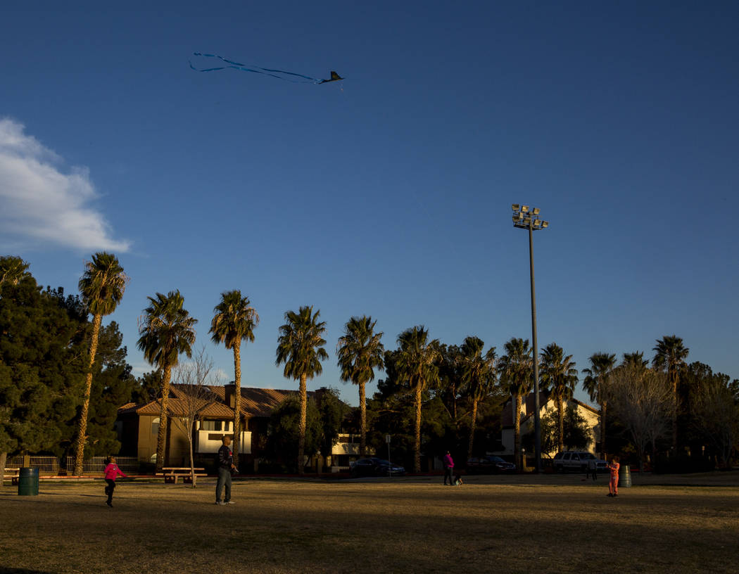 Las Vegas resident Chris Murray flies kites with his daughter Arayah Murray, 5, right, and granddaughter Sydney Graham, 7, during a breezy late afternoon in Sunset Park in Las Vegas on Wednesday,  ...