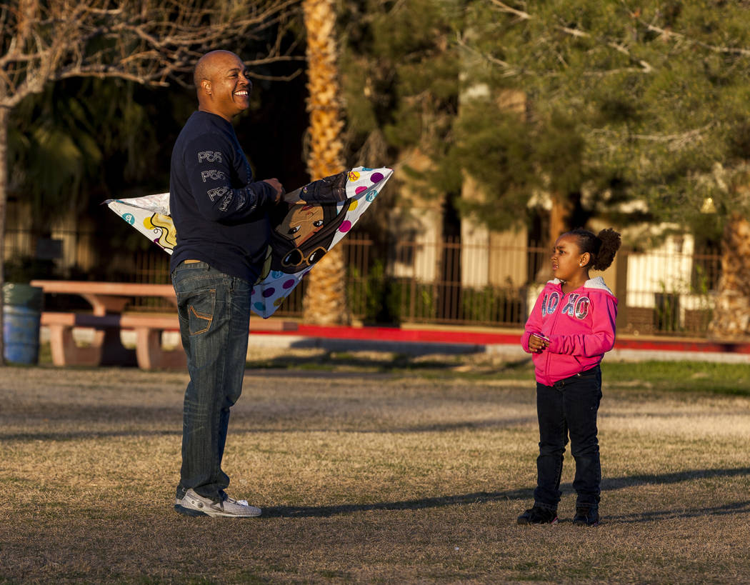 Las Vegas resident Chris Murray helps his granddaughter Sydney Graham, 7, with her kite during a breezy afternoon at Sunset Park in Las Vegas on Wednesday, Feb. 28, 2018.  Patrick Connolly Las Veg ...
