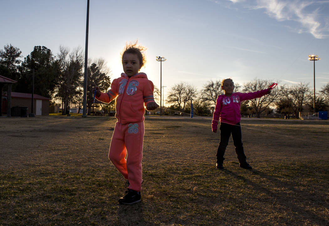 Las Vegas residents Arayah Murray, 5, left, and Sydney Graham, 7, fly kites during a breezy late afternoon in Sunset Park in Las Vegas on Wednesday, Feb. 28, 2018.  Patrick Connolly Las Vegas Revi ...