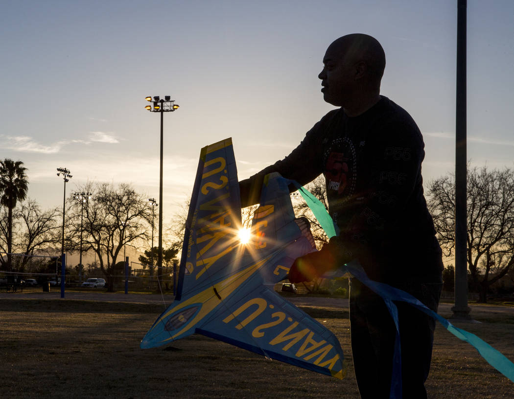 Las Vegas resident Chris Murray helps his daughter and granddaughter with kite flying during a breezy late afternoon in Sunset Park in Las Vegas on Wednesday, Feb. 28, 2018.  Patrick Connolly Las  ...
