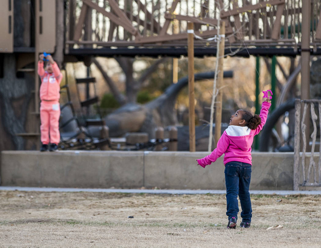 Las Vegas residents Sydney Graham, 7, flies her kite along with Arayah Murray, 5, in the background during a breezy late afternoon in Sunset Park in Las Vegas on Wednesday, Feb. 28, 2018.  Patrick ...