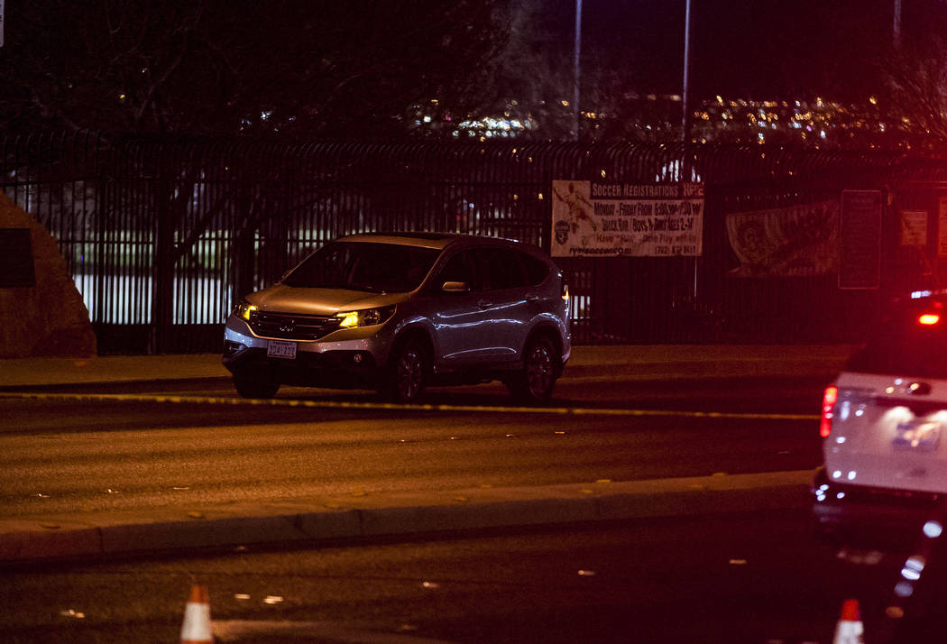 A Honda CR-V has its flashers on at the scene of an accident where a child died near the intersection of South Durango Drive and West Spring Mountain Road in Las Vegas on Wednesday, Feb. 28, 2018. ...