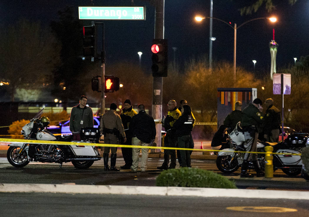 The Metropolitan Police Department investigates the scene of an accident where a child died near the intersection of South Durango Drive and West Spring Mountain Road in Las Vegas on Wednesday, Fe ...