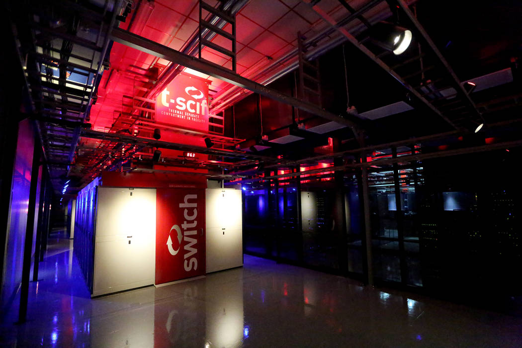 The Switch Data Sector houses rows of multi-cabinet heat containment chimney pods (t-scif) that channel computer generated heat up and out of the data center at the Switch Core Campus in Las Vegas ...