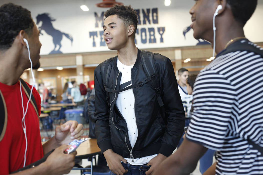 D'Andre Burnett, 17, talks to friends during lunch at Shadow Ridge High School in Las Vegas, Thursday, Oct. 19, 2017. Burnett has a 50-50 chance of graduating, and faces the same obstacles thousan ...