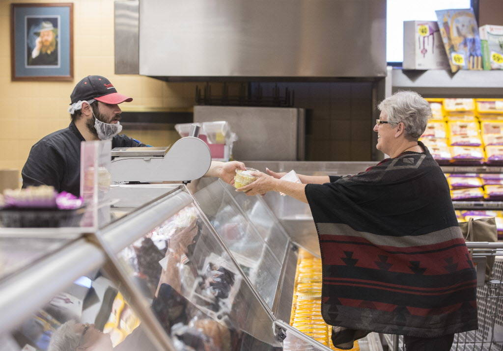 Kosher clerk Zalman Goldblatt, left, serves potato salad to Penny Delzer in the deli of the Kosher Experience section at Smith's at 2211 N. Rampart Blvd on Wednesday, January 10, 2018, in Las Vega ...