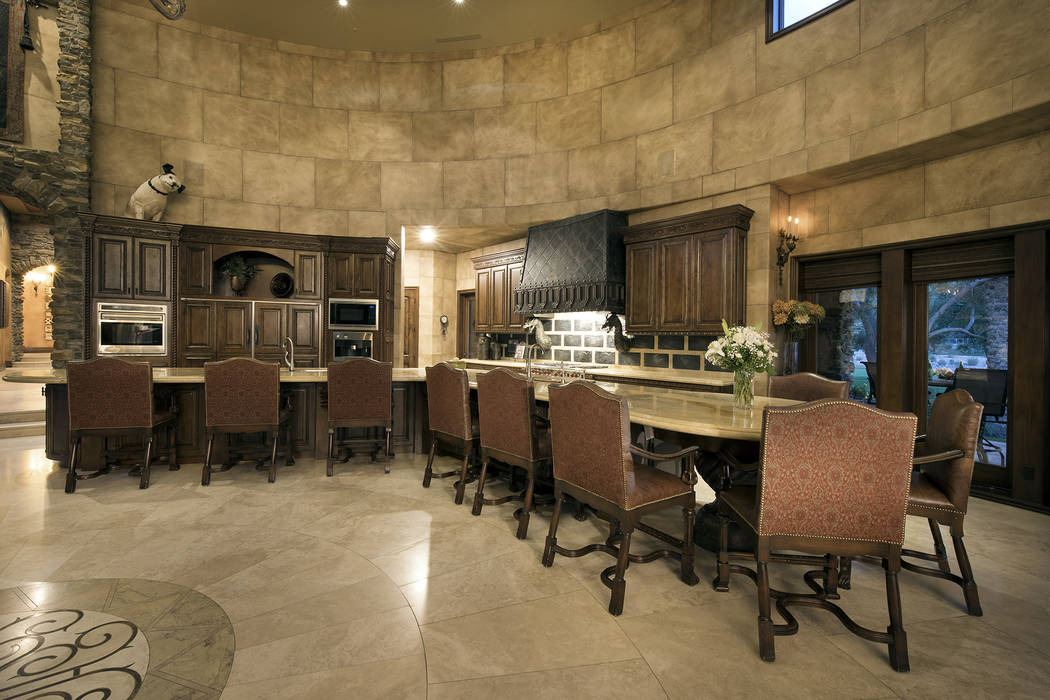 The kitchen has a large island for seating. (Synergy/Sotheby's International Realty)