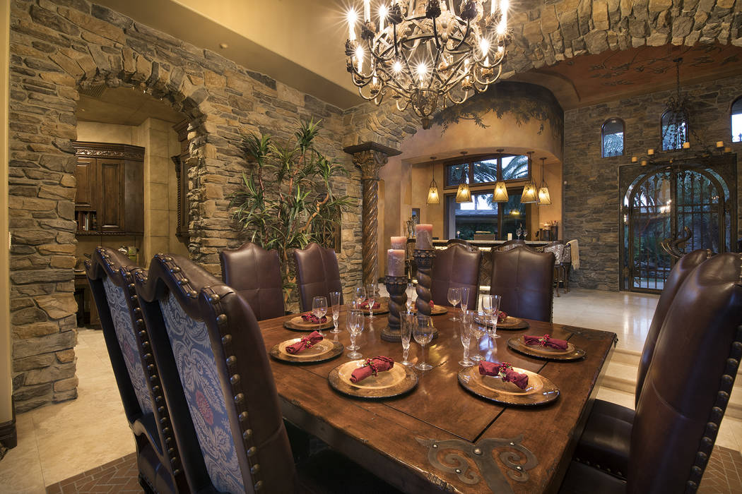 The home's formal dining room is off the entrance to the pool. (Synergy/Sotheby's International Realty)