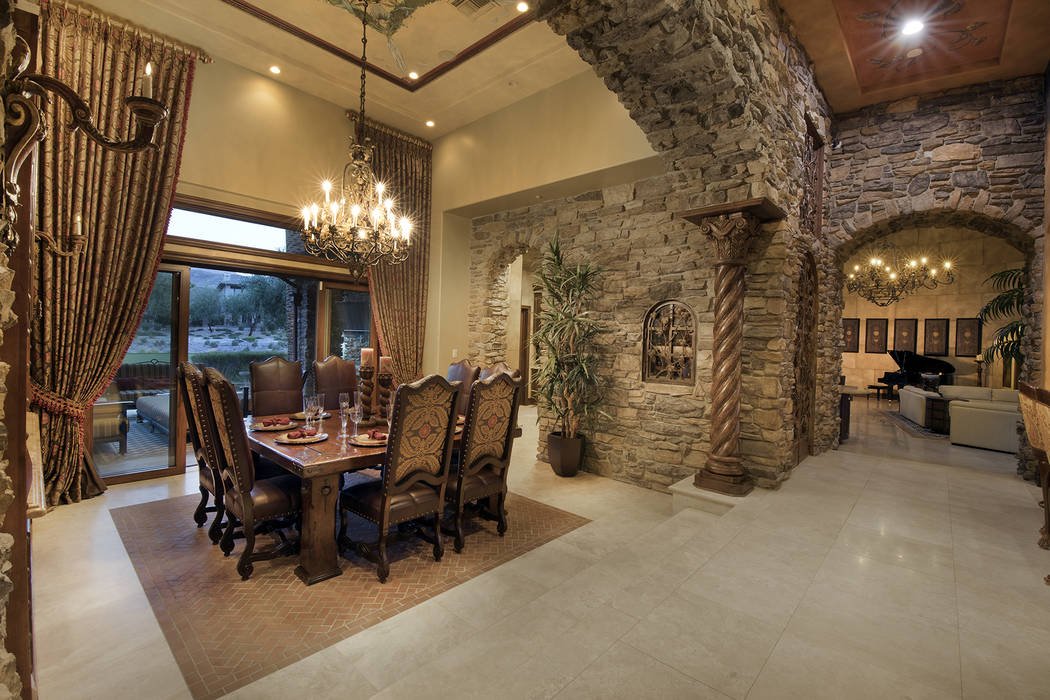 The dining room has golf course views. (Synergy/Sotheby's International Realty)
