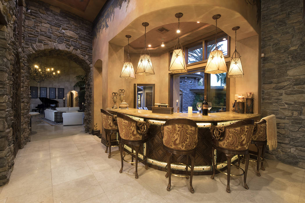 Built for entertainment the home has several bar areas. (Synergy/Sotheby's International Realty)
