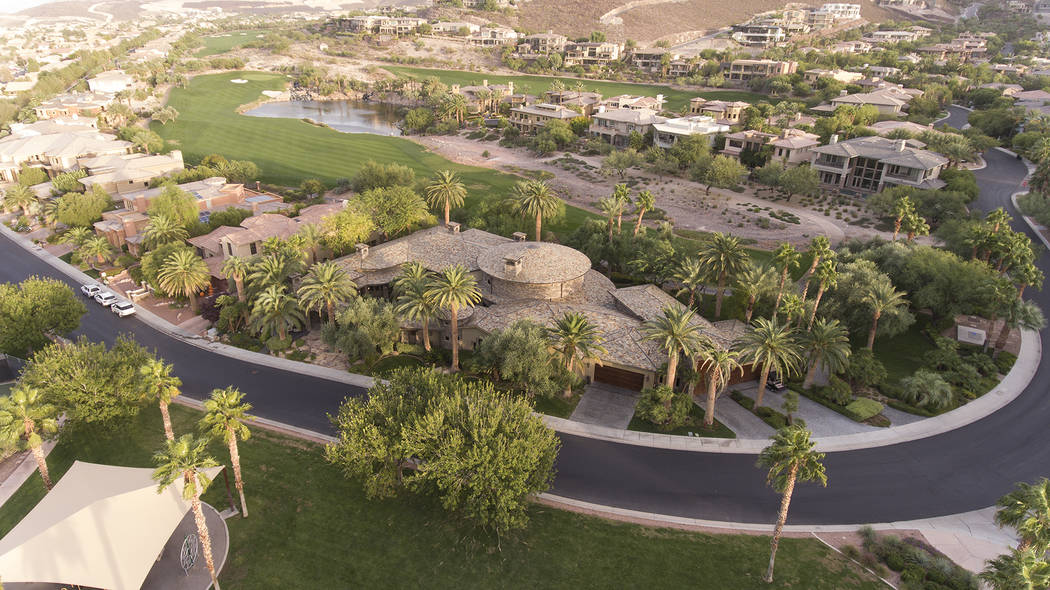 Dragon Rock at MacDonald Highlands sits on the seventh hole of DragonRidge Golf Course. It's listed for $3.5 million. (Synergy/Sotheby's International Realty)
