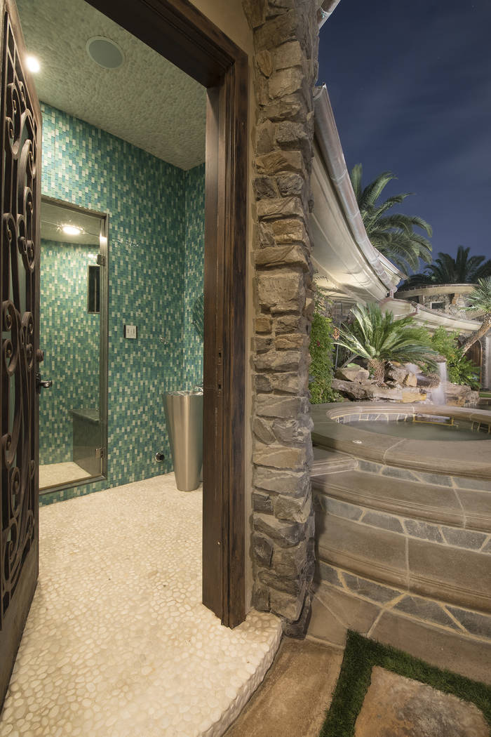 There is a bathroom at the pool. (Synergy/Sotheby's International Realty)