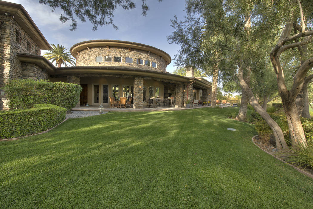 The home has lush landscaping. (Synergy/Sotheby's International Realty)