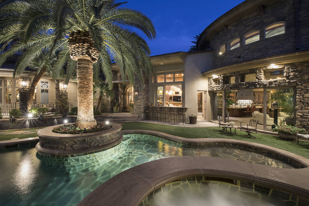 Dragon Rock at MacDonald Highlands features a front courtyard and pool. (Synergy/Sotheby's International Realty)