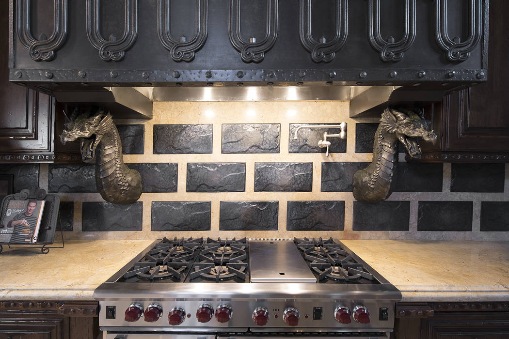 Lava tiles and dragons are above the stove in the kitchen. (Synergy/Sotheby's International Realty)