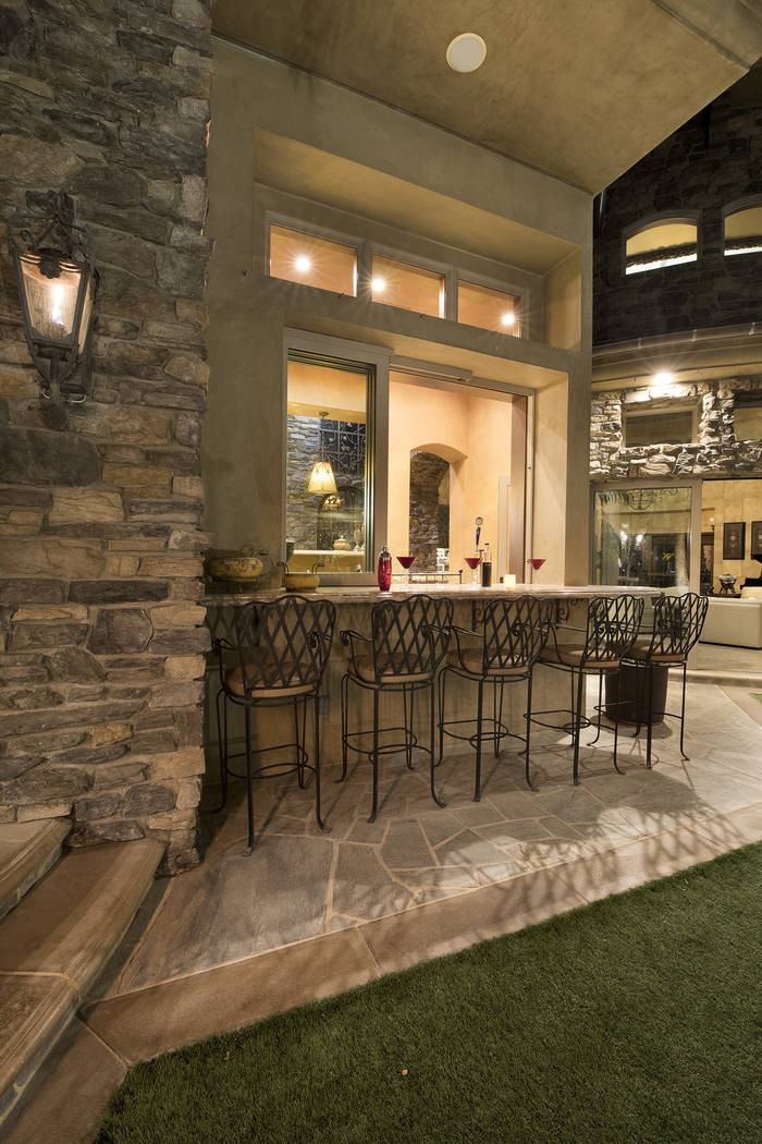The front court yard features a bar area. (Synergy/Sotheby's International Realty)