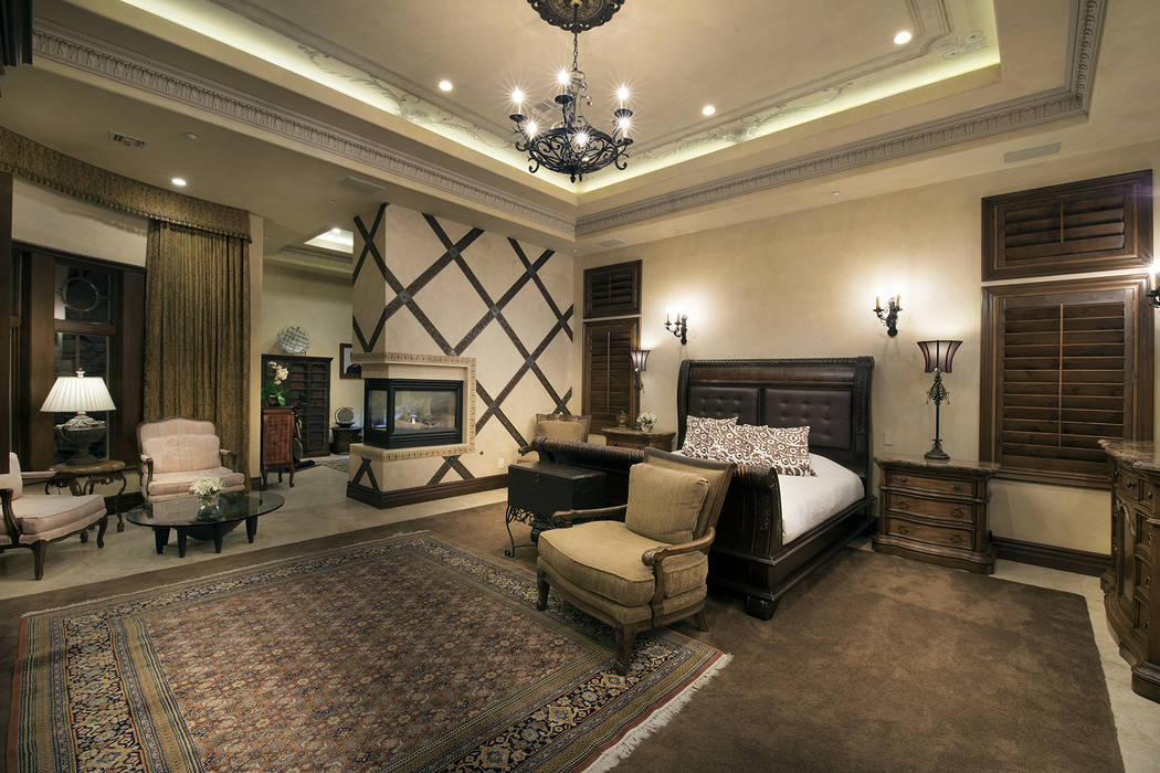 The large master suite has a three-sided fireplace. (Synergy/Sotheby's International Realty)