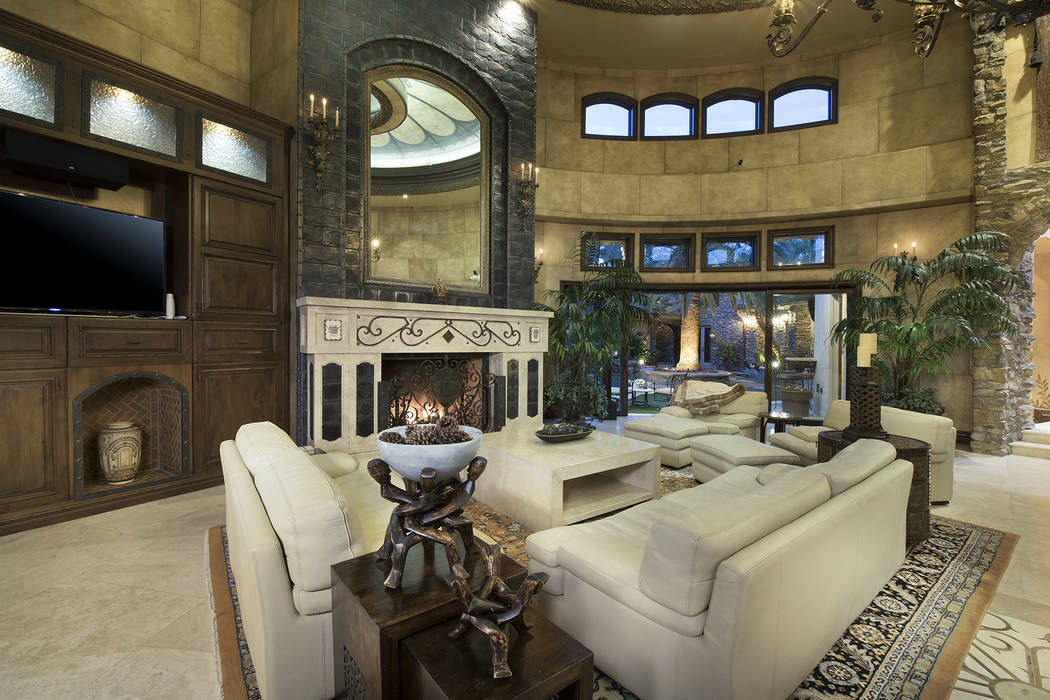 Above the fireplace are custom lava rock tiles. (Synergy/Sotheby's International Realty)