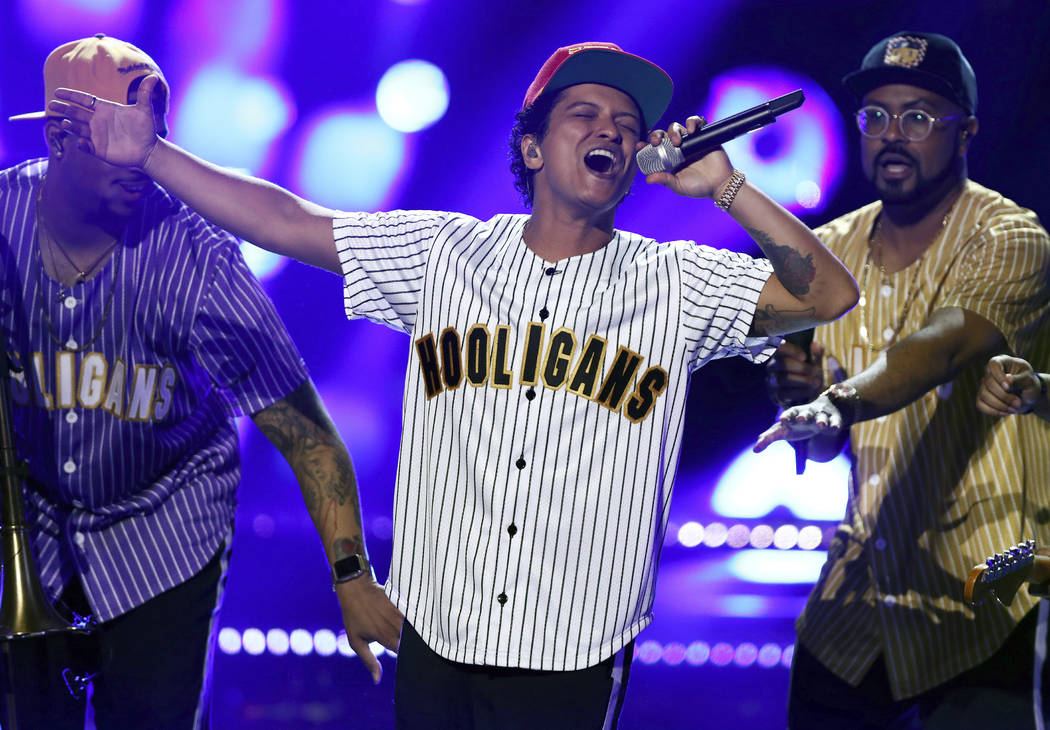 """Bruno Mars performs """"Perm"""" at the BET Awards at the Microsoft Theater in Los Angeles.  (Photo by Matt Sayles/Invision/AP, File)"""