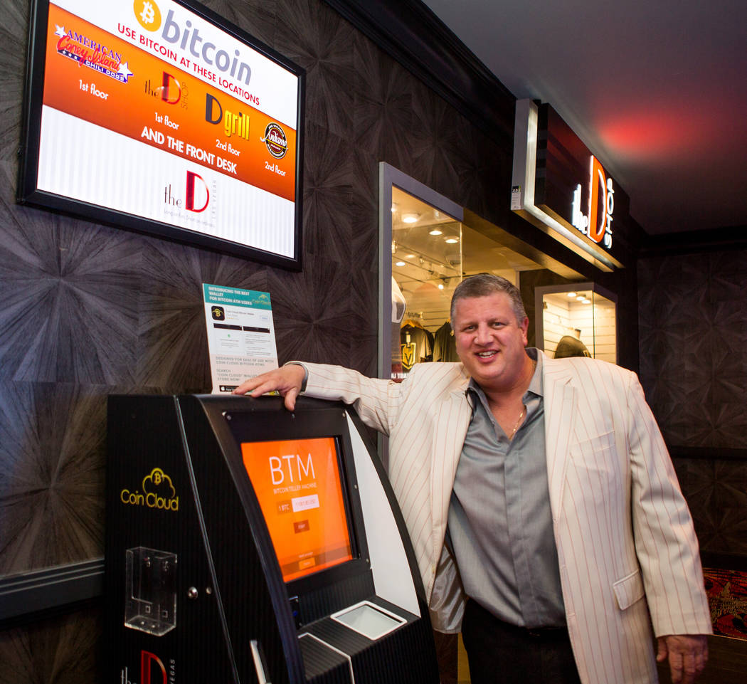 Derek Stevens, CEO and owner of the D Las Vegas, in front of a Bitcoin ATM in the D Las Vegas on Thursday, Feb. 15, 2018. The hotel-casino is now accepting Bitcoin at some of its restaurants, gift ...