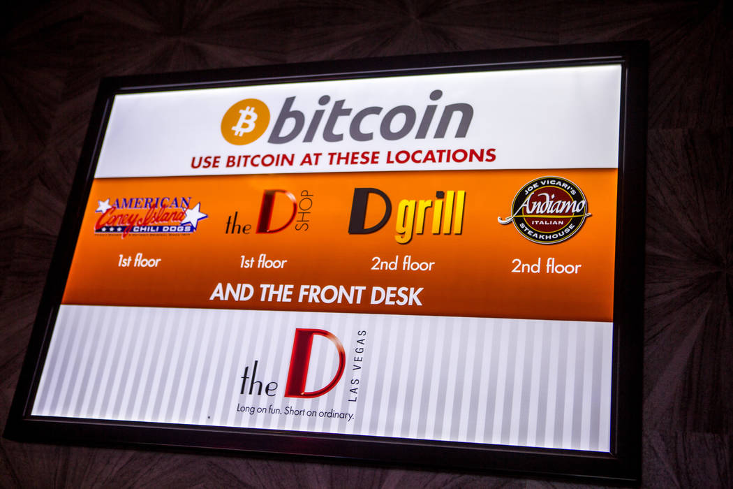 Signs advertise the use of Bitcoin at the D Las Vegas on Thursday, Feb. 15, 2018. The hotel-casino is now accepting Bitcoin at some of its restaurants, gift shop and hotel desk.  Patrick Connolly  ...