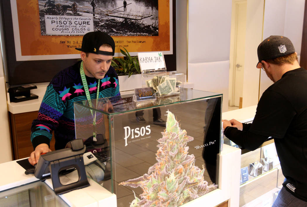 Budtender Patrick Murphy, left, at Pisos dispensary, at 4110 S. Maryland Pkwy. in Las Vegas Monday, Jan. 22, 2018. Pisos is on the forefront of using cryptocurrency in the Nevada marijuana industr ...