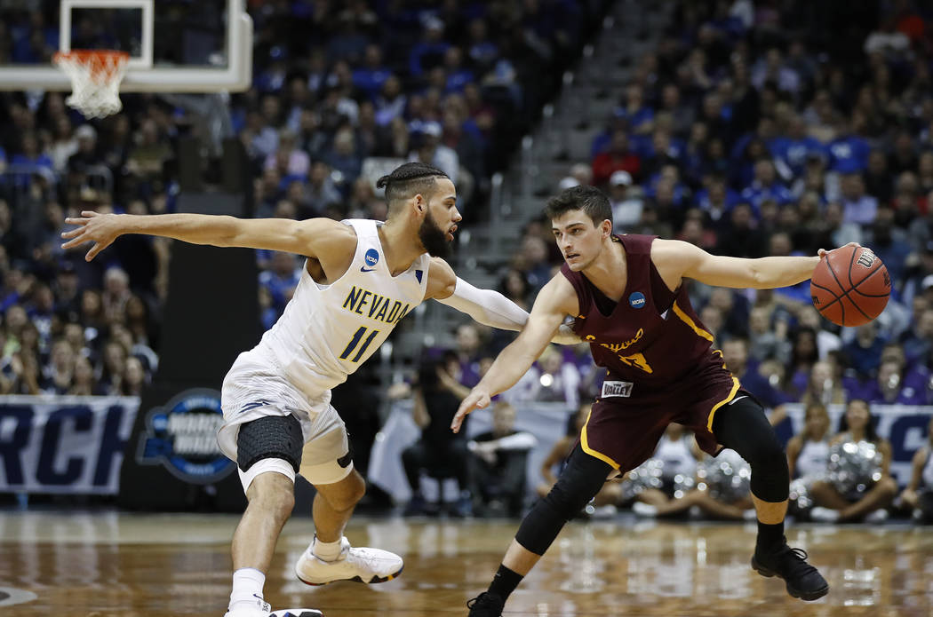 Loyola-Chicago guard Clayton Custer (13) works against Nevada forward Cody Martin (11) during the second half of a regional semifinal NCAA college basketball game, Thursday, March 22, 2018, in Atl ...