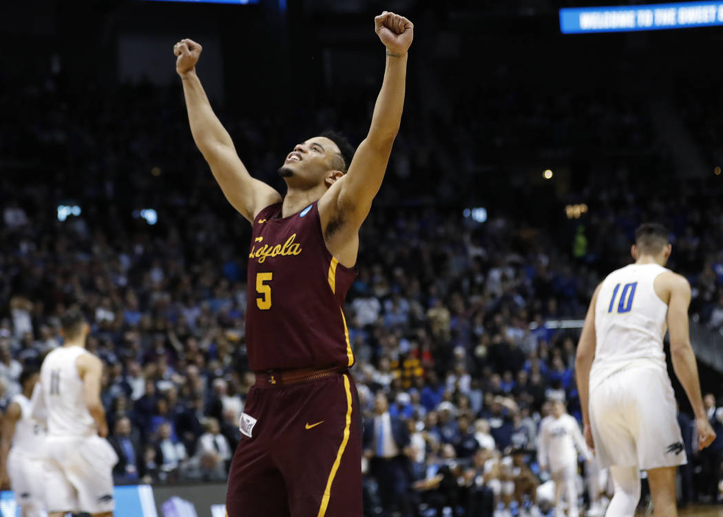 Loyola-Chicago guard Marques Townes celebrates victory after a regional semifinal NCAA college basketball game against Nevada, Thursday, March 22, 2018, in Atlanta. Loyola-Chicago won 69-68. (AP P ...