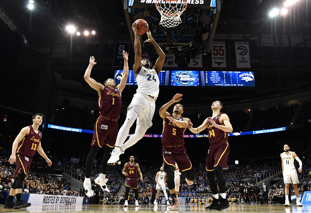 Nevada guard Jordan Caroline (24) shoots against Loyola-Chicago guard Lucas Williamson (1) during the second half of a regional semifinal NCAA college basketball game, Thursday, March 22, 2018, in ...