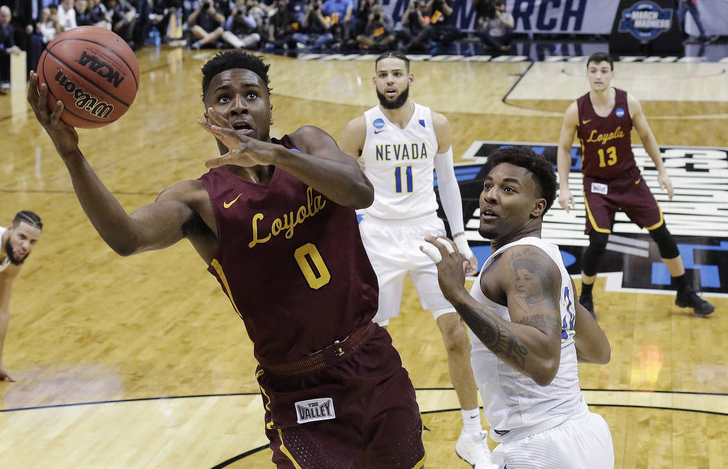 Loyola-Chicago guard Donte Ingram (0) shoots against Nevada guard Jordan Caroline (24) during the second half of a regional semifinal NCAA college basketball game, Thursday, March 22, 2018, in Atl ...