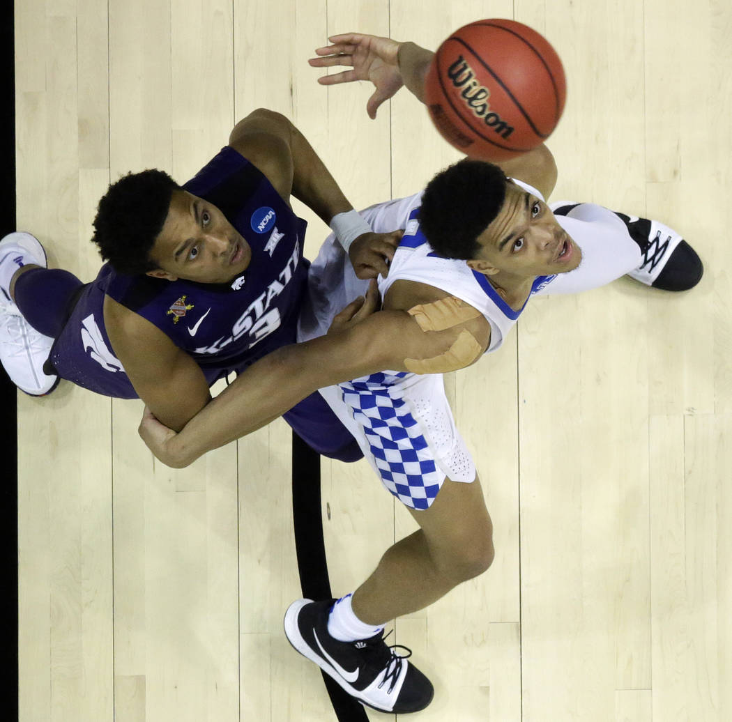 Kansas State guard Kamau Stokes (3) and Kentucky forward Kevin Knox (5) wait for a ball during the second half of a regional semifinal NCAA college basketball tournament game, Friday, March 23, 20 ...