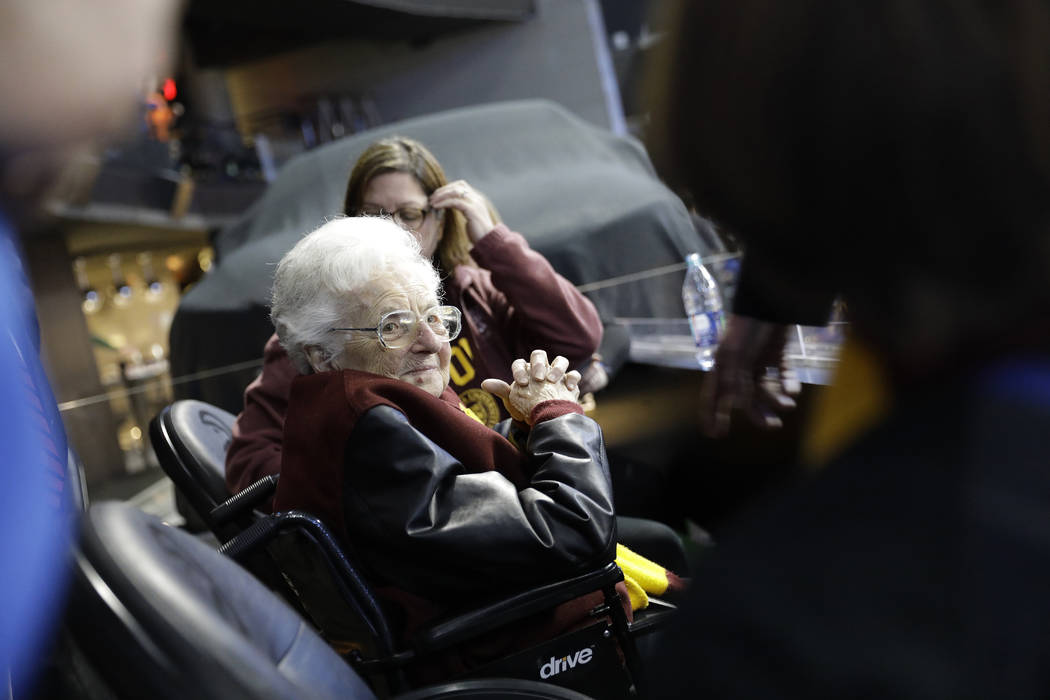 Sister Jean Dolores Schmidt sits with other Loyola-Chicago fans during the first half of a regional semifinal NCAA college basketball game against Nevada, Thursday, March 22, 2018, in Atlanta. (AP ...