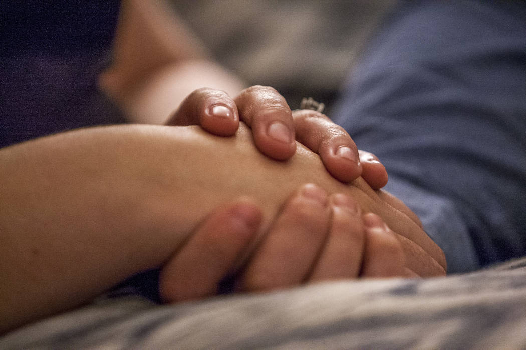 William King, aRoute 91 Harvest festival shooting survivor,holds hands with hisfiancéeKimberly King at their Summerlin home on Wednesday, Jan. 31, 2018. Patrick Connol ...