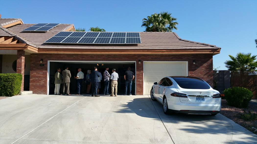 A homeowner uses photovoltaic solar panels to generate electric power for both his residential home and a Tesla Model S electric car. (Stan Hanel RJNewHomes.Vegas)