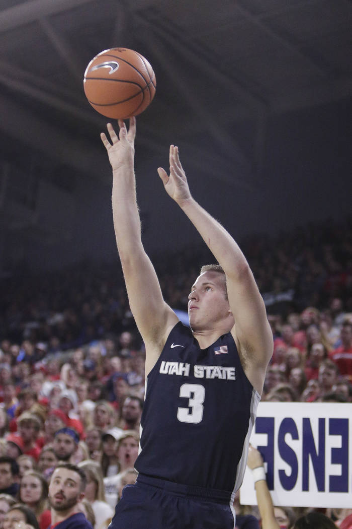 Utah State guard Sam Merrill (3) shoots during the first half of an NCAA college basketball game against Gonzaga in Spokane, Wash., Saturday, Nov. 18, 2017. (AP Photo/Young Kwak)