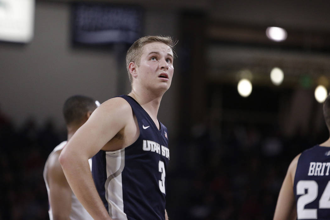 Utah State guard Sam Merrill (3) stands on the court during the first half of an NCAA college basketball game against Gonzaga in Spokane, Wash., Saturday, Nov. 18, 2017. (AP Photo/Young Kwak)