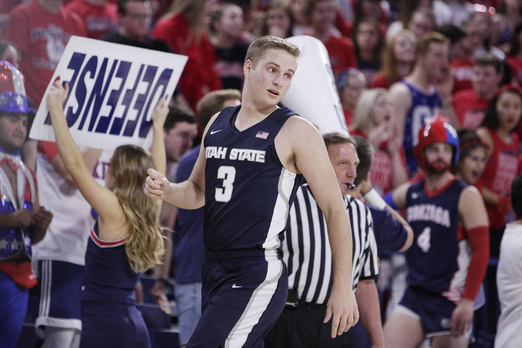 Utah State guard Sam Merrill (3) walks on the court during the second half of an NCAA college basketball game against Utah State in Spokane, Wash., Saturday, Nov. 18, 2017. (AP Photo/Young Kwak)