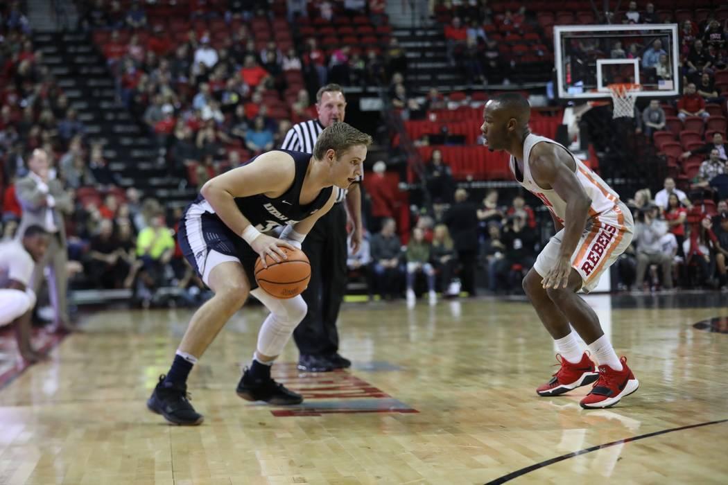 Utah State's Sam Merrill is defended by UNLV's Jordan Johnson on Jan. 6 at the Thomas & Mack Center. Photo courtesy of UNLV athletics.