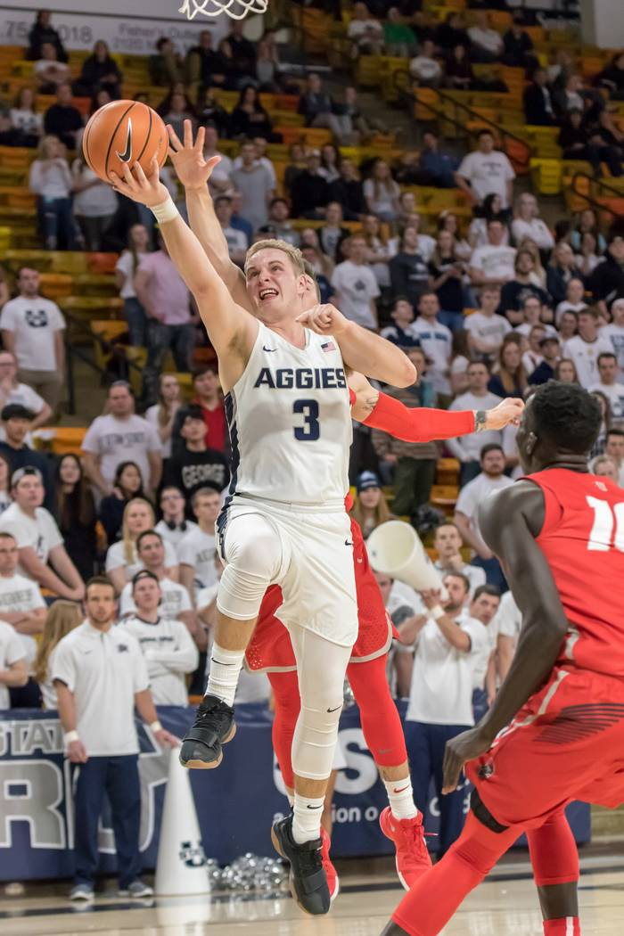 Utah State's Sam Merrill drives to the basket against New Mexico on Jan. 31. Photo courtesy of Rick Parker, Utah State athletics.
