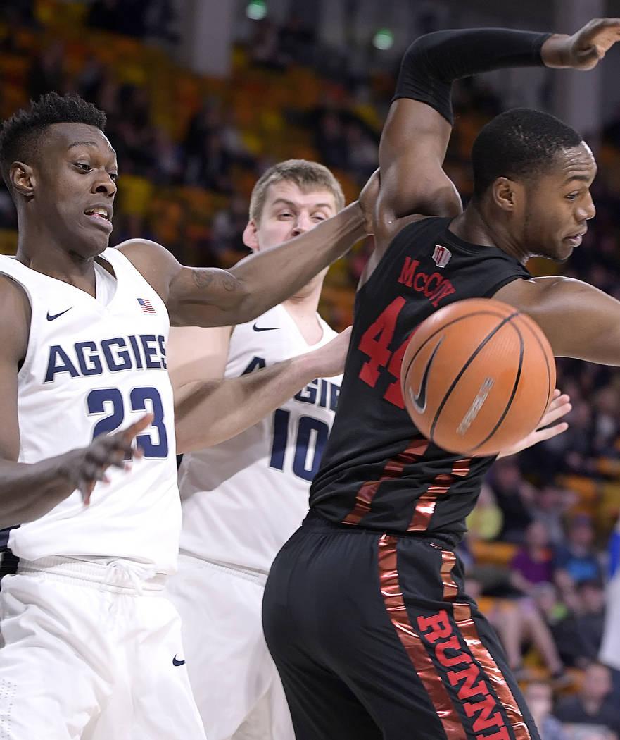 Utah State forward Daron Henson (23) and forward Quinn Taylor (10) vie for a rebound against UNLV forward Brandon McCoy (44) during an NCAA college basketball game Saturday, March 3, 2018, in Loga ...