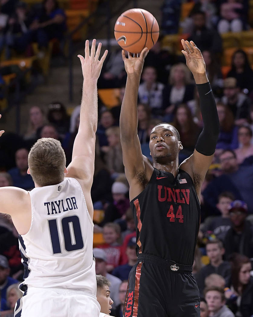 UNLV forward Brandon McCoy (44) shoots over Utah State forward Quinn Taylor (10) during an NCAA college basketball game Saturday, March 3, 2018, in Logan, Utah. (Eli Lucero/The Herald Journal via AP)