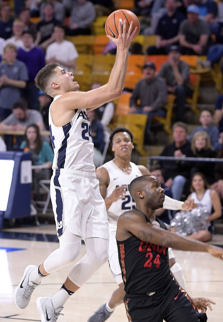 Utah State guard Diogo Brito, left, shoots as UNLV guard Jordan Johnson defends during an NCAA basketball game Saturday March 3, 2018, in Logan, Utah. (Eli Lucero/Herald Journal via AP)/The Herald ...