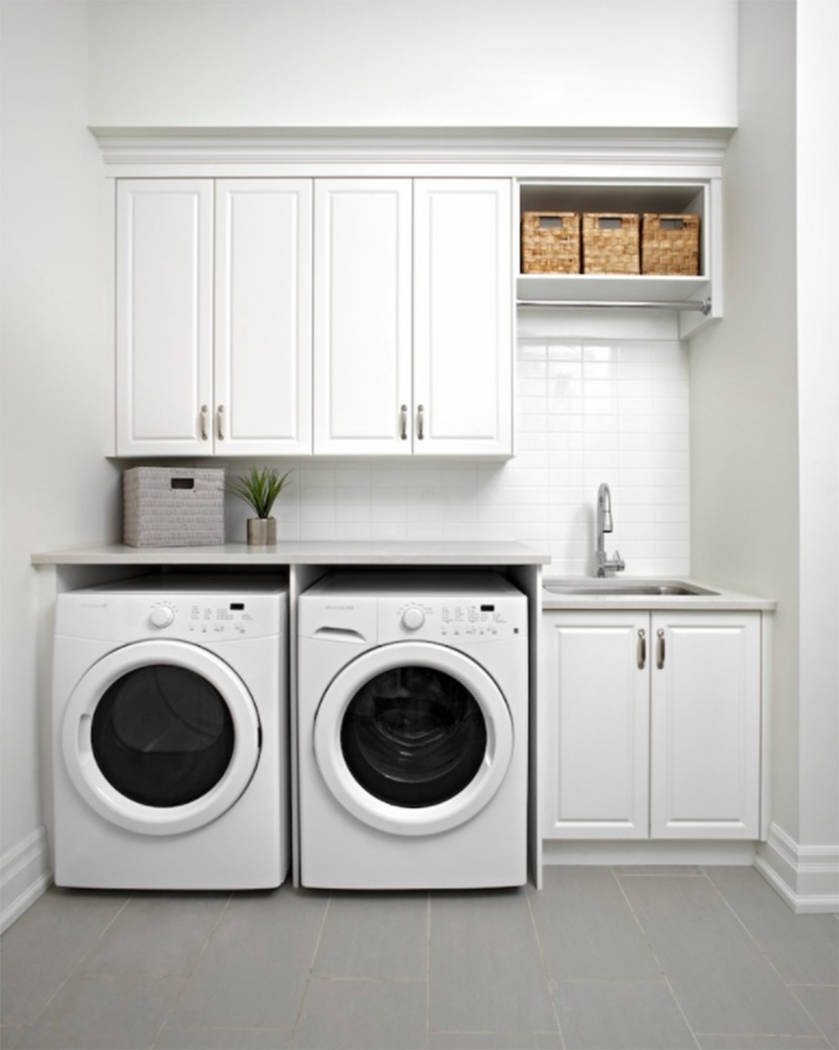 Houzz This is the typical laundry room you find in a lot of models -- and it includes everything you need.
