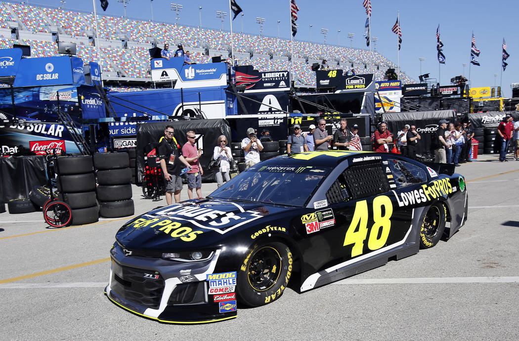 Jimmie Johnson drives out to the track at practice for the NASCAR Daytona 500 auto race at Daytona International Speedway, Saturday, Feb. 17, 2018, in Daytona Beach, Fla. (AP Photo/Terry Renna)