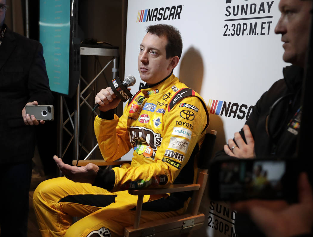 Kyle Busch answers questions during an interview at media day for the NASCAR Daytona 500 auto race at Daytona International Speedway, Wednesday, Feb. 14, 2018, in Daytona Beach, Fla. (AP Photo/Joh ...